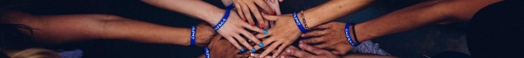 banner image of many hands coming together