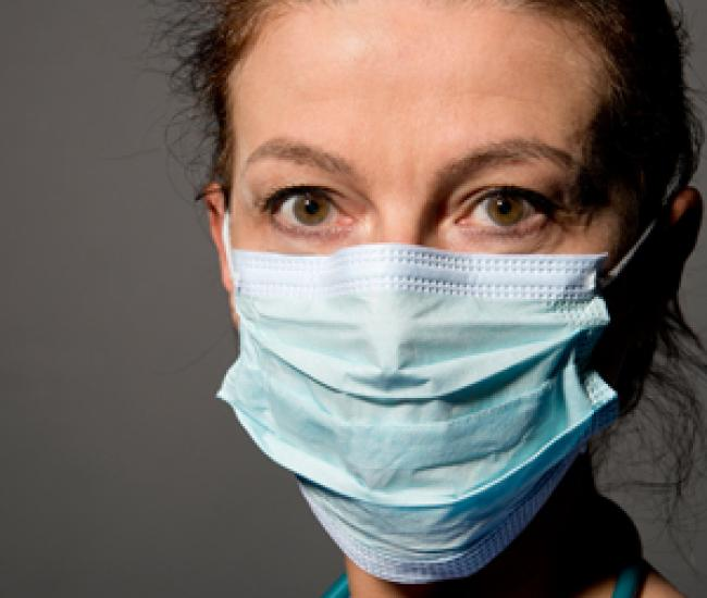 Health care worker wearing medical mask