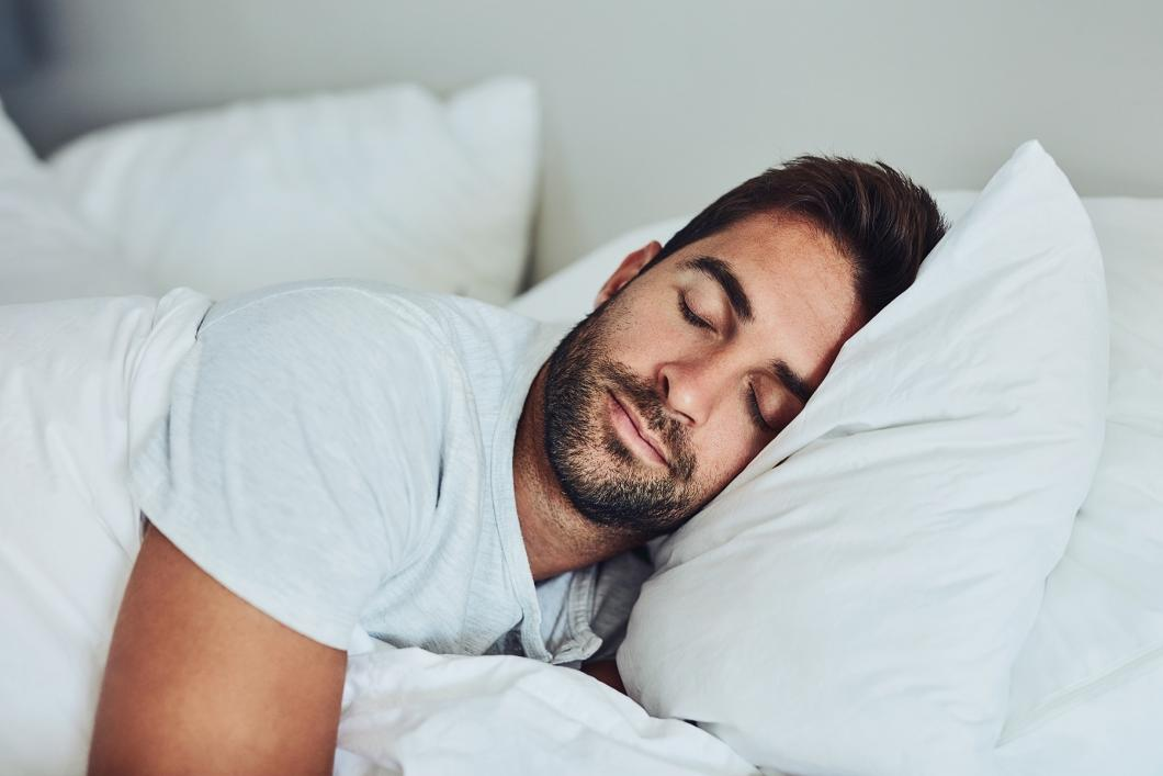 Man sleeping with head on pillow