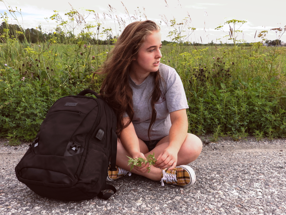 Girl sitting with her backpack