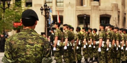Canadian military members stand in formation.