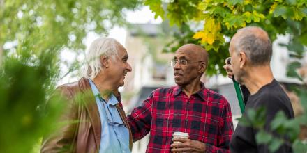 Men socializing outside in the community